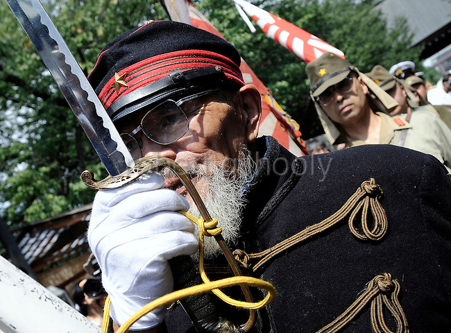Dressed in Edo-period military garb, Hakugaku Kuribayashi, 80, leads a march to prayer during a events to commemorate the anniversary of the end of World War II at Yasukuni Shrine in Tokyo, Japan on 15 Aug. 2008. Wartime prime minister Hideki Tojo - who ordered the attack on Peal Harbor and was charged and hanged as a war criminal after World War II, is enshrined inside the controversial Yasukuni Shrine together with 13 other convicted war criminals, a fact that still angers citizens in China and South Korea, both of which fell vicim to Japan's wartime activities. Aug 15. is the anniversary of Japan's surrender in World War II and 100s of thousands of pilgrims from around the country visit the shrine...Photographer: Robert Gilhooly
