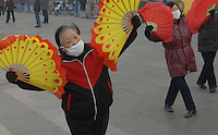 Ladies wear protective masks while practising early morning fan dancing & Tai Chi in Linfen, Shanxi Province, China. Linfen is reportedly the most polluted city in China and at the heart of the coal mining industry. China produces around 2.4 billion tones of coal annually that contributes to more than 400,000 premature deaths annually due to air pollution, acid rain and poisonous ground water. It also contributes to global warming...PHOTO BY SINOPIX