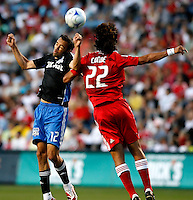 San Jose midfielder Ramiro Corrales (12) heads the ball in front of Chicago Fire defender Wilman Conde (22).  The Chicago Fire tied the San Jose Earthquakes 0-0 at Toyota Park in Bridgeview, IL on June 28, 2008.