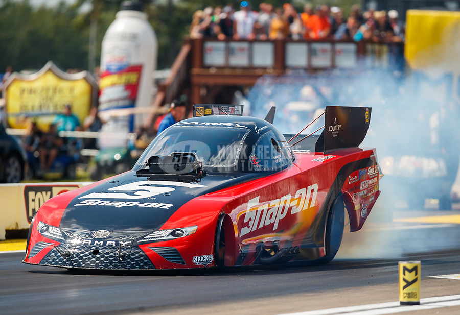 Aug 19, 2017; Brainerd, MN, USA; Crew members for NHRA funny car driver Cruz Pedregon during qualifying for the Lucas Oil Nationals at Brainerd International Raceway. Mandatory Credit: Mark J. Rebilas-USA TODAY Sports