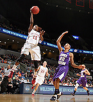 Oklahoma guard Danielle Robinson (13) shoots in front of James Madison guard Tarik Hislop (22) during in the first round of the NCAA women's college basketball tournament Sunday, March 20, 2011 in Charlottesville, Va. Oklahoma won 86-72. (AP Photo/ Andrew Shurtleff)