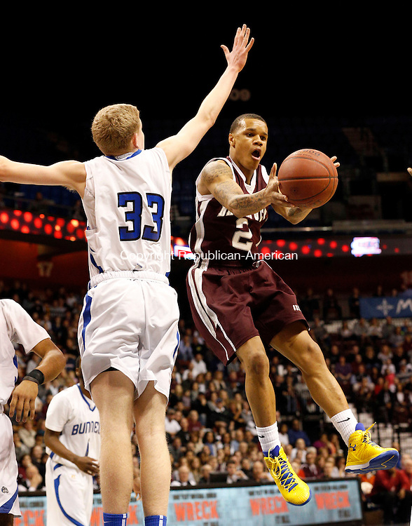 Uncasville, CT- 22 March 2015-032215CM04- Naugatuck's Jarron Chapman (2) dishes off a pass away from Bunnell's Patrick Gough during their first half matchup in the Class L state championship game at Mohegan Sun Arena in Uncasville on Sunday.    Christopher Massa Republican-American