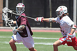 Orange, CA 05/01/10 - William Morrison (Chapman # 1) and Travis Abraham (LMU # 9) in action during the LMU-Chapman MCLA SLC semi-final game in Wilson Field at Chapman University.  Chapman advanced to the final by defeating LMU 19-10.