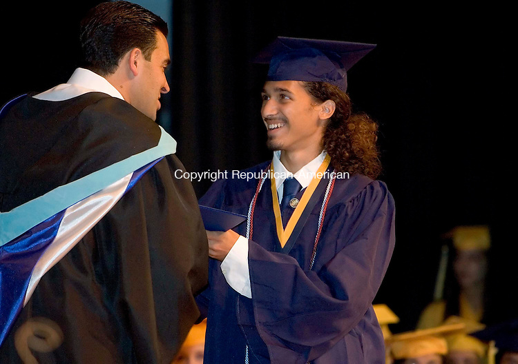WATERBURY, CT --JUNE 16, 2008-061608JS15-Kennedy High School graduate Amir Mualem, who will attending Princton University, receives his diploma from Kennedy High School principal Michael P. Yarmin during Monday's commencement exercises at Kennedy High School in Waterbury. <br /> Jim Shannon/Republican-American