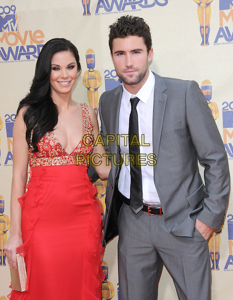 JAYDE NICOLE & BRODY JENNER.The 2009 MTV Movie Awards held at Universal Ampitheatre  in Universal City, California, USA..May 31st, 2009  .half length red gold dress grey gray suit jacket couple stubble facial hair jewel encrusted embellished cleavage.CAP/DVS.©Debbie VanStory/Capital Pictures.