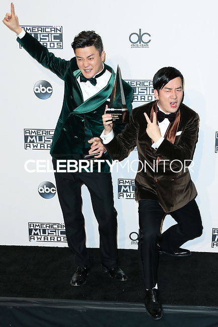 LOS ANGELES, CA, USA - NOVEMBER 23: Xiao Yang, Wang Tali, Chopstick Brothers pose in the press room at the 2014 American Music Awards held at Nokia Theatre L.A. Live on November 23, 2014 in Los Angeles, California, United States. (Photo by Xavier Collin/Celebrity Monitor)