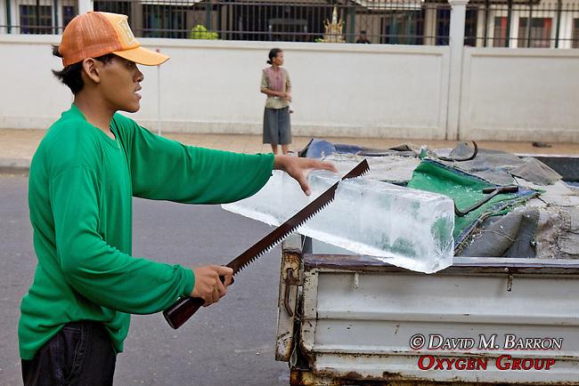 Man Cutting Ice Block