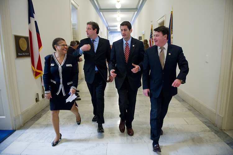 WASHINGTON, DC - April 06: Rep. Karen Bass, D-Calif., Rep. Tim Ryan, D-Ohio, Chairman Paul D. Ryan, R-Wis., and Rep. Todd Rokita, R-Ind., return to the committee meeting room after a floor vote during the House Budget markup of Chairman Ryan's 2012 budget plan. (Photo by Scott J. Ferrell/Congressional Quarterly)