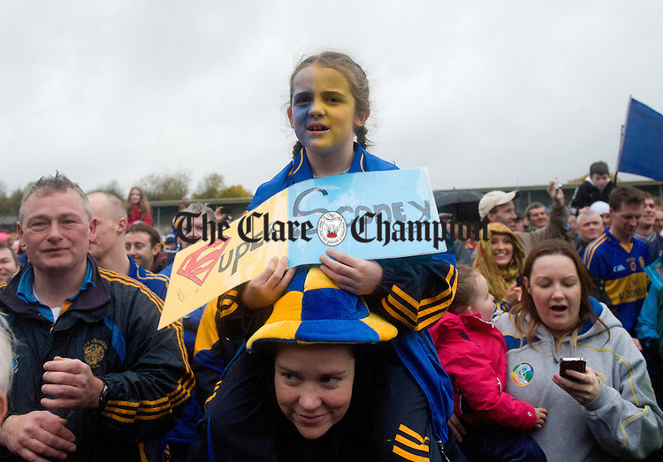 Newmarket fan Kaci Toomey looks on at the cup presentation following the senior county hurling final at Cusack Park. Photograph by John Kelly.