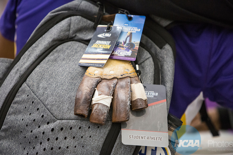 COLLEGE STATION, TX - MARCH 11: Johnnie Jackson of Louisiana State University and his backpack after his win in the weight thrown during the Division I Men's and Women's Indoor Track & Field Championship held at the Gilliam Indoor Track Stadium on the Texas A&M University campus on March 11, 2017 in College Station, Texas. (Photo by Michael Starghill/NCAA Photos/NCAA Photos via Getty Images)