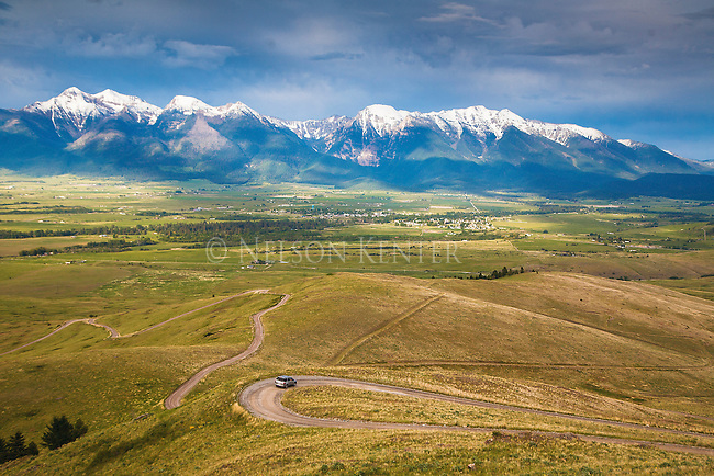 a car in the mission valley in western montana viewing the snow capped mission mountains