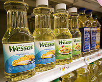Bottles of Wesson vegetable oil on a supermarket shelf in New York on Tuesday, May 30, 2017. Conagra Brands is reported to be selling its Wesson oil brand to J.M. Smucker Co. for approximately $285 million. Wesson will join Smucker's Crisco oil brand. (© Richard B. Levine)