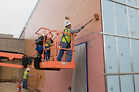 Crew members paint the side of a building at a new middle school, Thursday, January 9, 2019 on the corner of North Vaughn and Holloway roads in Centerton<br /> <br /> The Bentonville School District is preparing to open its fourth junior high school this fall, Grimsley Junior High School. Check out nwaonline.com/200111Daily/ for today's photo gallery.<br /> (NWA Democrat-Gazette/Charlie Kaijo)