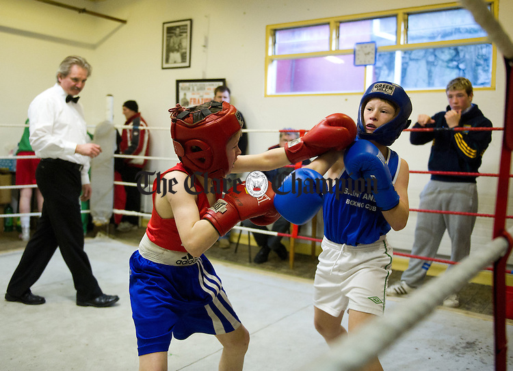 Thomas P Doherty of Ennis in action against Cian Kennedy, Westport during the annual Westport V Ennis boxing tournament at Ennis Boxing Club. Photograph by John Kelly.