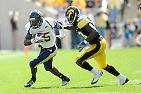 6 September 2008:  FIU defensive back Alonzo Phillips (25) attempts to evade Iowa defensive back Amari Spievey (19) in the second half of the Iowa 42-0 victory over FIU at Kinnick Field in Iowa City, Iowa.