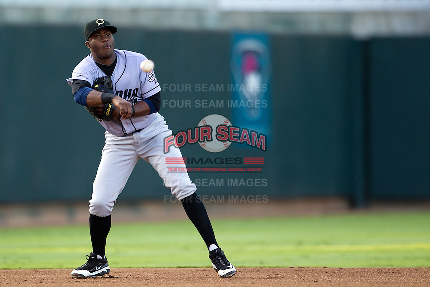 Omaha Storm Chasers shortstop Irving Falu #12 throws the ball to second during the Pacific Coast League baseball game against the Round Rock Express on July 22, 2012 at the Dell Diamond in Round Rock, Texas. The Express defeated the Chasers 8-7 in 11 innings. (Andrew Woolley/Four Seam Images).