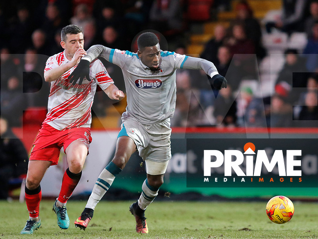Grimsby's Omar Bogle holds off Stevenage's Steven Schumacher during the Sky Bet League 2 match between Stevenage and Grimsby Town at the Lamex Stadium, Stevenage, England on 28 January 2017. Photo by Carlton Myrie / PRiME Media Images.