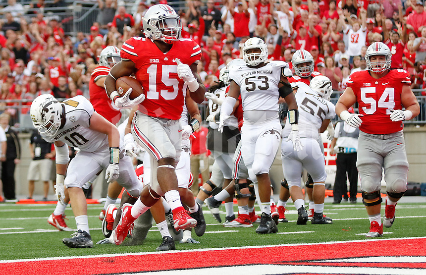 Ohio State Buckeyes running back Ezekiel Elliott (15) rushes for a touchdown in the third quarter of the college football game between the Ohio State Buckeyes and the Western Michigan Broncos at Ohio Stadium in Columbus, Saturday afternoon, September 26, 2015. The Ohio State Buckeyes defeated the Western Michigan Broncos 38 - 12. (The Columbus Dispatch / Eamon Queeney)