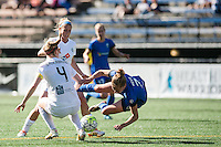 Seattle, WA - Sunday, May 1, 2016: FC Kansas City defender Becky Sauerbrunn (4) and Seattle Reign FC defender Elli Reed (7) collide at the top of the box during a National Women's Soccer League (NWSL) match at Memorial Stadium.