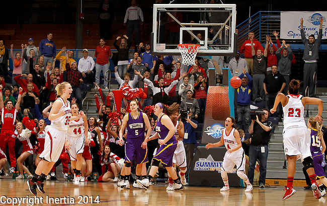 SIOUX FALLS, SD - MARCH 9: The University of South Dakota celebrates their game winning basket with 1.1 seconds left to defeat Western Illinois 96-94 in their semifinal game at the 2014 Summit League Tournament in Sioux Falls, SD.  (Photo by Dave Eggen/Inertia)