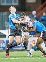 Picture by Allan McKenzie/SWpix.com - 09/02/2018 - Rugby League - Betfred Super League - Wakefield Trinity v Salford Red Devils - The Mobile Rocket Stadium, Wakefield, England - Wakefield's Justin Horo fends off Salford's Craig Kopczak & Ben Nakubuwai.