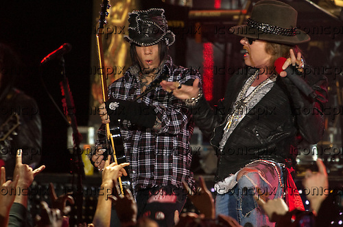 GUNS N' ROSES - guitarist DJ Ashba and vocalist Axl Rose performing live in at the Palladium in Hollywood, CA USA - March 9, 2012.  Photo © Kevin Estrada / Iconicpix