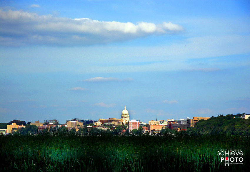 A postcard-like photograph of the city of Madison, Wisconsin skyline.