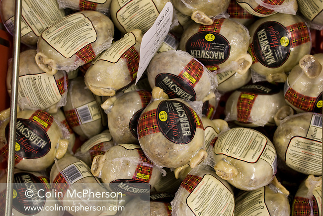Freshly produced vacuum packed haggis ready for distribution at the Macsween factory in Roslin, near Edinburgh. The Macsween family has been making authentic, award-winning haggis in Edinburgh for over 50 years. Haggis is indelibly linked to Scotland's national poet, Robert Burns (1759 - 1796) and is made by encasing boiled meat in a sheep's stomach, which is then traditionally eaten with mash potato and turnip.