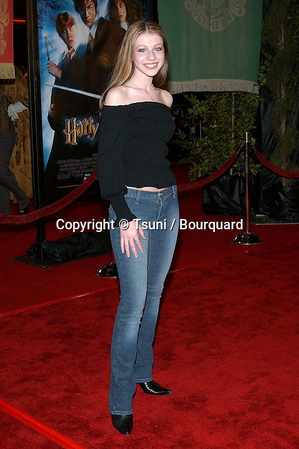 """Michelle Trachtenberg arriving at the premiere of """"Harry Potter and the Chamber of Secrets""""  at the Westwood Village Theatre in Los Angeles. November 14, 2002."""