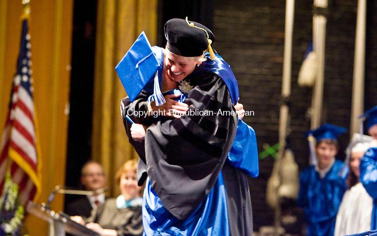 TORRINGTON, CT - 22 JUNE 2010 -062210JT09-<br /> Lewis Mills graduate John Biancucci hugs Principal Dr. Karissa Niehoff after receiving his diploma during commencement ceremonies at the Warner Theatre in Torrington on Tuesday.<br /> Josalee Thrift Republican-American