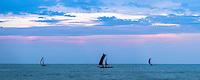 Negombo, panoramic photo of a traditional Sri Lankan fishing boats (oruva) returning to Negombo fishing market at sunrise, Sri Lanka, Asia. This is a panoramic photo of traditional Sri Lankan fishing boats (known locally as Oruva) returning to Negombo fishing market at sunrise in Sri Lanka, Asia.