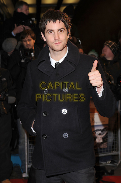 "JIM STURGESS .attending ""The Way Back"" UK film premiere, Curzon Mayfair cinema, London, England, UK,.8th December 2010 ..half length black coat white shirt hand thumb up gesture .CAP/BEL.©Tom Belcher/Capital Pictures."
