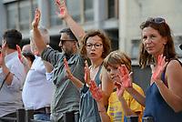 Roma, 29 Agosto 2018<br /> Cittadine e cittadine antirazziste con le mani tinte di rosso a simboleggiare il sangue dei migranti morti in mare, protestano davanti il Viminale contro le politiche sull'immigrazione del Governo e del Ministro Salvini