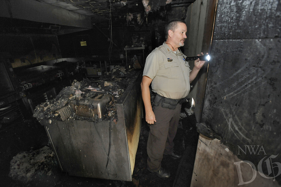 NWA Democrat-Gazette/ANDY SHUPE<br /> Monte Fuller, superintendent of Devi's Den State Park, leads a tour Friday, Aug. 28, 2015, of the historic Civilian Conservation Corps building at the park. The building sustained damage from a fire Thursday evening that has forced the closure of the Ridgerunner Cafe and associated gift shop. Visit nwadg.com/photos to see more from the scene.