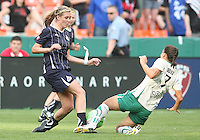 Allie Long #9 of the Washington Freedom  is tackled by Shannon Boxx #7 of St. Louis Athletica during a WPS match on May 1 2010, at RFK Stadium, in Washington D.C. Freedom won 3-1.
