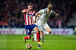 Toni Kroos (r) of Real Madrid competes for the ball with Gabriel Fernandez Arenas, Gabi, of Atletico de Madrid during the La Liga 2017-18 match between Atletico de Madrid and Real Madrid at Wanda Metropolitano  on November 18 2017 in Madrid, Spain. Photo by Diego Gonzalez / Power Sport Images