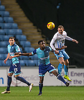 Stuart Beavon of Coventry City beats Anthony Stewart of Wycombe Wanderers in the air during the The Checkatrade Trophy - EFL Trophy Semi Final match between Coventry City and Wycombe Wanderers at the Ricoh Arena, Coventry, England on 7 February 2017. Photo by Andy Rowland.