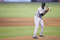 Augusta GreenJackets relief pitcher Sandro Cabrera (28) looks to his catcher for the sign against the Kannapolis Intimidators at Kannapolis Intimidators Stadium on June 21, 2019 in Kannapolis, North Carolina. The Intimidators defeated the GreenJackets 6-1. (Brian Westerholt/Four Seam Images)