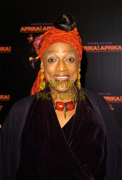 """JESSIE NORMAN.""""Afrika! Afrika!"""" VIP premiere, O2 Arena, London, England..January 17th, 2008.headshot portrait orange headscarf gold earrings dangling beads necklace beaded .CAP/CAN.©Can Nguyen/Capital Pictures"""