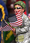 Landon Munoz, 5, watches the Veteran's Day Parade in Virginia City, Nev., on Tuesday, Nov. 11, 2014.<br /> Photo by Cathleen Allison