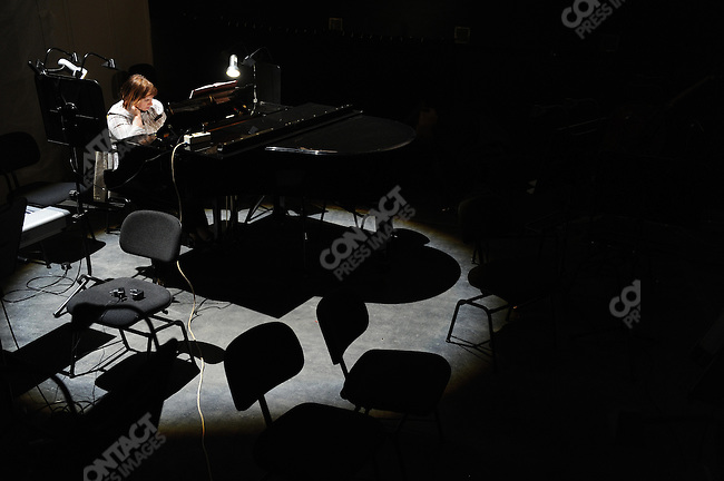 On the stage of the newly refurbished building of the historical Bolshoi theatre, the opera 'Ruslan and Ludmilla' is currently being rehearsed under the direction of Dmitry Chernyakov.  In the orchestra pit a pianist waited for rehearsals to start. Moscow, Russia, October 19, 2011