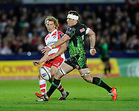 Billy Twelvetrees of Gloucester Rugby chips past Kai Horstmann of Exeter Chiefs during the European Rugby Challenge Cup semi final match between Gloucester Rugby and Exeter Chiefs at Kingsholm Stadium on Saturday 18th April 2015 (Photo by Rob Munro)