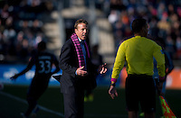 Phildelphia Union head coach John Hackworth talks to a referee during a Major League Soccer game at PPL Park in Chester, PA. Sporting Kansas City defeated the Philadelphia Union, 2-1.