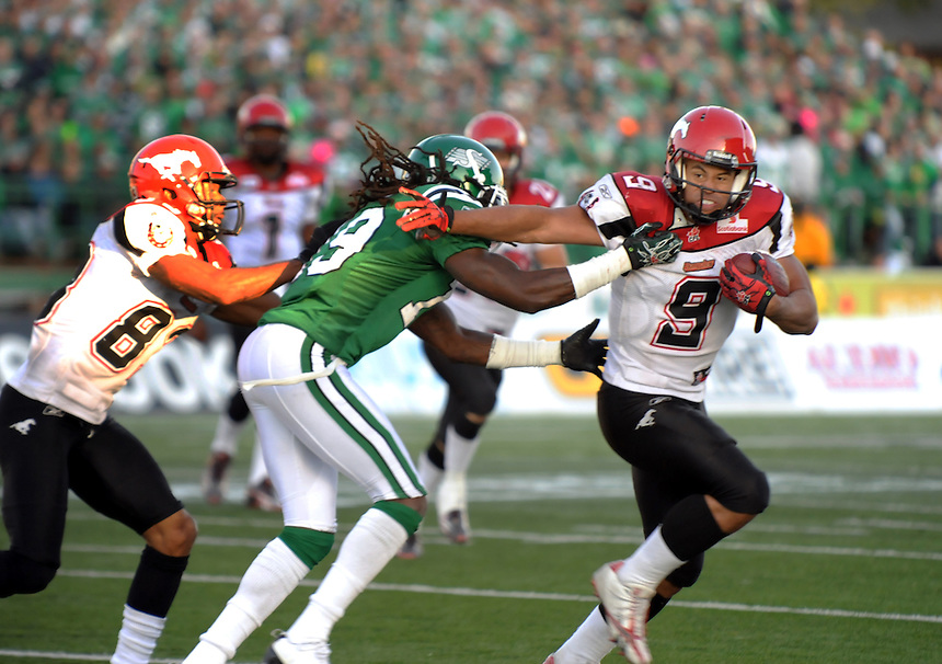 Calgary Stampeders running back Jon Cornish runs  the ball against the Saskatchewan Roughriders during CFL action in Regina Sunday, October 17, 2010. THE CANADIAN PRESS/Mark Taylor.