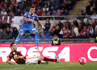 Calcio, Serie A: Roma vs Empoli. Roma, stadio Olimpico, 17 ottobre 2017.<br /> Empoli&rsquo;s Rade Krunic is tackled by Roma&rsquo;s Kostas Manolas, bottom, during the Italian Serie A football match between Roma and Empoli at Rome's Olympic stadium, 17 October 2015.<br /> UPDATE IMAGES PRESS/Isabella Bonotto