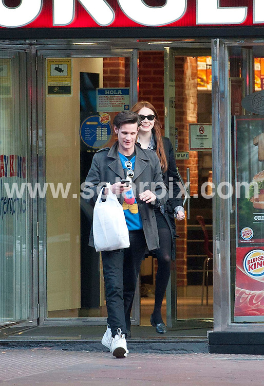 "**ALL ROUND EXCLUSIVE PICTURES FROM SOLARPIX.COM** .**UK MAGAZINES**.**DOUBLE SPACE RATES APPLY**MINIMUM PUBLICATION FEE £150.00 PER PICTURE**                                                                                                                                             **WORLDWIDE SYNDICATION RIGHTS EXCEPT SPAIN - NO SYNDICATION IN SPAIN**                                                                                  Dr Who filming in Spain..Dr Who actor Matt Smith and Karen Gillan who plays his companion Amy Pond are currently in Almeria, Spain, filming an episode called ""Gun Slingers""..Matt & Karen were spotted out and about in the city of Almeria on their day off from filming. They visited a local cafe then took a stroll to Burger King. They were both busy on their mobile phones.                                                                         This pic:    Matt Smith and Karen Gillan                                                                                     JOB REF:   14555   RAP       DATE:  12.03.12                                                          **MUST CREDIT SOLARPIX.COM OR DOUBLE FEE WILL BE CHARGED**                                                                      **MUST AGREE FEE BEFORE ONLINE USAGE**                               **CALL US ON: +34 952 811 768 or LOW RATE FROM UK 0844 617 7637**"