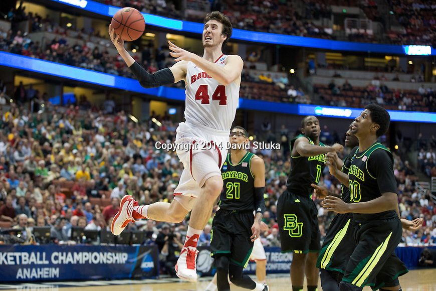 Wisconsin Badgers center Frank Kaminsky (44) shoots the ball during  a regional semifinal NCAA college basketball tournament game against the Baylor Bears Thursday, March 27, 2014 in Anaheim, California. The Badgers won 69-52. (Photo by David Stluka)