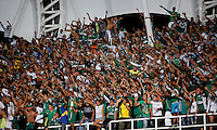 CALI- COLOMBIA -22 -01-2014: Hinchas del Deportivo Cali, animan a su equipo durante partido de ida por la Super Liga 2014, en el estadio Pascual Guerrero de la ciudad de Cali. / Fans of Deportivo Cali cheer for their team during the match between Deportivo Cali and Atletico Nacional for the first leg of the Super Liga 2014 at the Pascual Guerrero Stadium in Cali city. Photo: VizzorImage  / Luis Ramirez / Staff.
