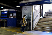 A woman, wearing a mask, exits the subway<br /> Roma 24/04/2020 <br /> City lockdown as a measure to contrast the covid-19 coronavirus pandemic <br /> Photo Andrea Staccioli Insidefoto