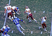 Washington Redskins running back John Riggins (44) carries the ball during the game against the Detroit Lions at RFK Stadium in Washington, D.C. on October 13, 1985.  The Redskins won the game 24 - 3..Credit: Arnie Sachs / CNP